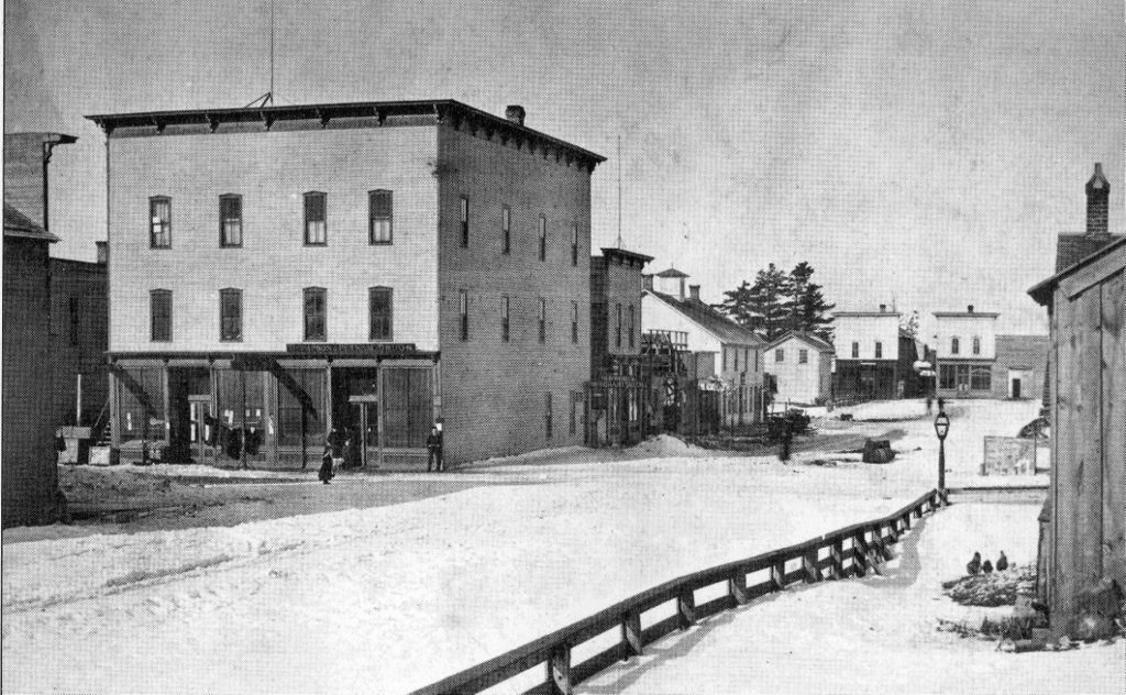 Pictured above is a circa 1890 photo of the corner of Cedar and Walnut Street in Manistique. The great fire of 1893 began in the rear of Paul Rediker's Saloon on Walnut Street and quickly spread to adjacent buildings.