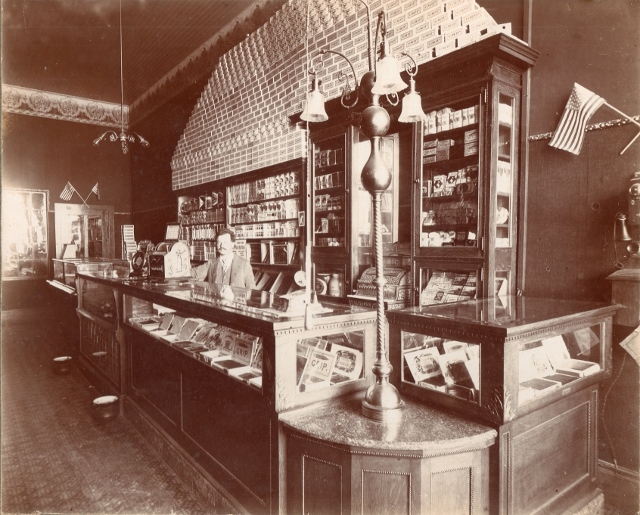 Peter Zimmerman standing behind the counter of his Cigar Factory Shop. Lyle Kotchen Collection