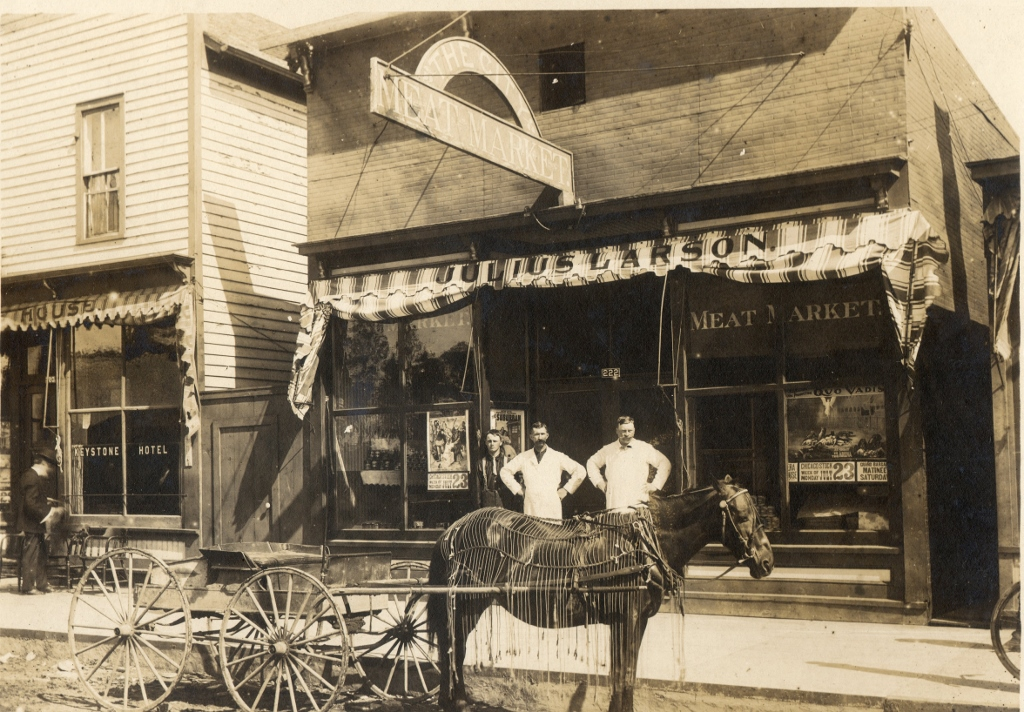 The City Meat Market was  opened in 1899. It stood on Oak Street next to the Barnes Hotel. In the above photo, posters can be seen in the widows advertising coming attractions at the opera house.